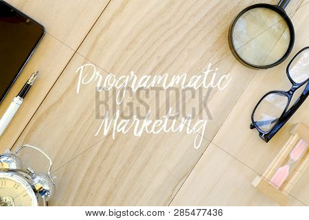 Top View Of Clock,pen,mobile Phone,magnifying Glass,glasses And Sand Clock On Wooden Background Writ