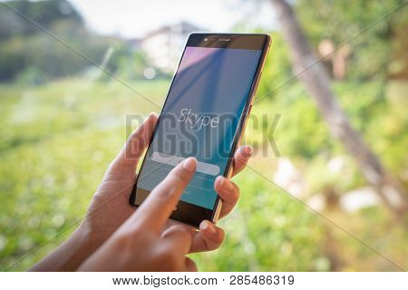 Chiang Mai, Thailand - Jan. 19,2019: Woman Holding Huawei With Skype Apps. Skype Is Part Of Microsof