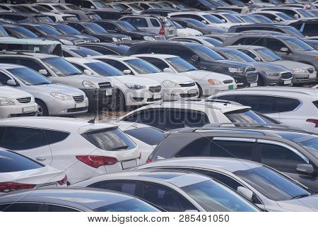 The Congestion At The Parking Lost With Lots Of Cars Are Parking Without Empty Space.