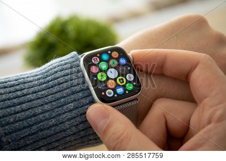 Anapa, Russia - February 17, 2019: Man Hand With Apple Watch Series 4 And Finger Touching Screen. Ap
