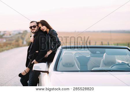 Authoritative point Wife on car hood
