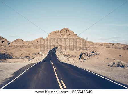 Nevada Desert Road, Color Toned Travel Concept Picture, Usa.