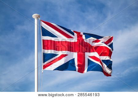 The National Flag Of The United Kingdom Is The Union Jack, Also Known As The Union Flag Waving On Wi