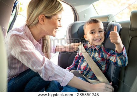 Cute Little Boy Sitting In The Child Seat