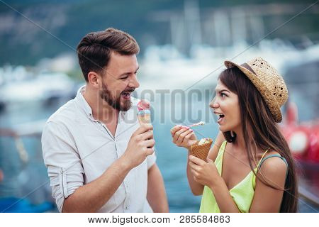 Happy Couple Having Date And Eating Ice Cream On Vacation. Sea Background.