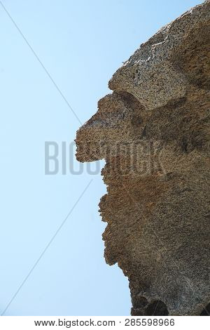 Rock Formation Located At Lia Beach In Mykonos, That Resembles A Man's Face