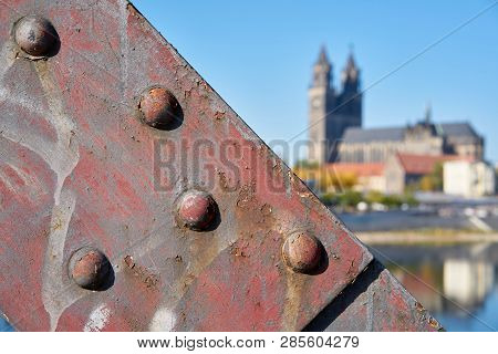 Detail Of The Lift Bridge In Magdeburg. In The Background The Magdeburg Cathedral, The Landmark Of T