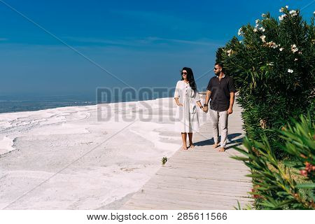 Man And Woman Traveling. Couple In Love Walking. Couple In Pamukkale. Travelling To Turkey. Lover. H