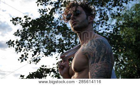 Muscular Shirtless Hunk Man Outdoor In Countryside