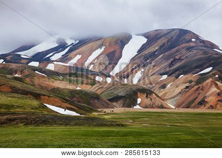 Visitors at the Landmannalaugar, a natural park in the Fjallabak Nature Reserve, famous for colourful mountains and natural geothermal hot springs, Southern Iceland, Scandinavia poster