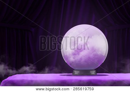 Crystal Magic Ball Standing On Purple Table With Dark Purple Curtains In Background. Concept Of Pred