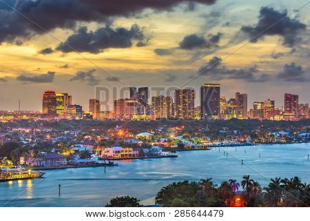Fort Lauderdale, Florida, USA skyline and river at dusk.