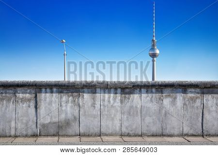 Berlin Wall With Tv Tower Against A Blue Sky