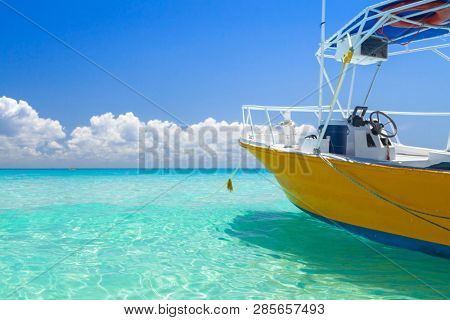 Yellow speedboat on the beach of Playacar at Caribbean Sea of Mexico