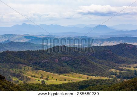 Rugged Landscape Of Forested Cliffs And Hills In Oreily, Qld, Australia