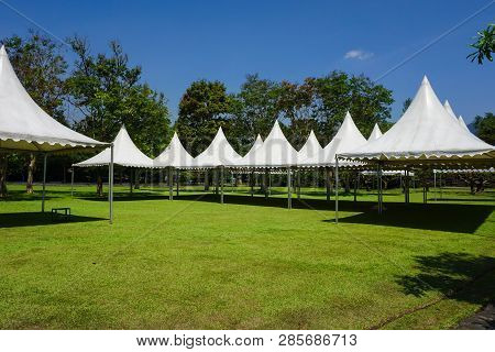 White Tent In Line In The Garden Park For Gardening Party - Photo Indonesia