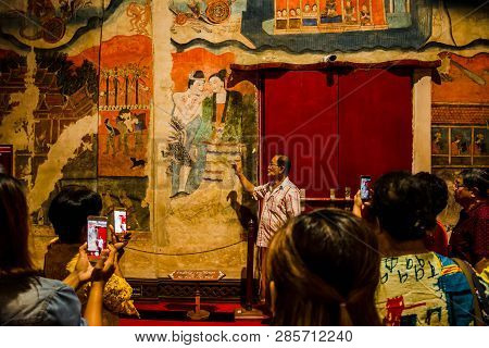 Phumin Temple, Nan, Thailand, July 9, 2017 : Local Guide Telling Story Of Temple And Mural Painting