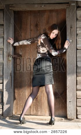 Teenage Girl Near Timber Door Of Old Country House