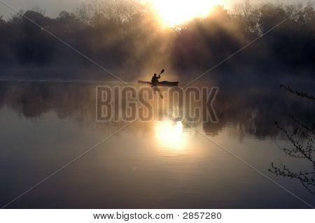 Kayaker At Dawn