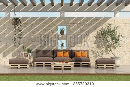Garden With Pallet Sofa And Wooden Pergola With Stone Wall On Background - 3d Rendering
