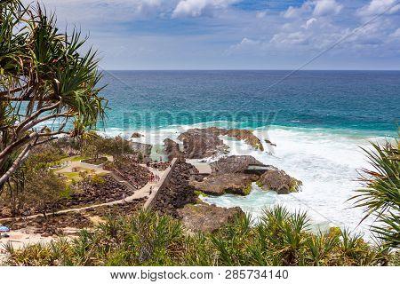 People Enjoying Snapper Rocks And Rock Pool  In Coolangatta, Qld, Australia