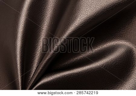 Dark brown eco leather. Artificial leather. Synthetic leather. Leatherette background. poster