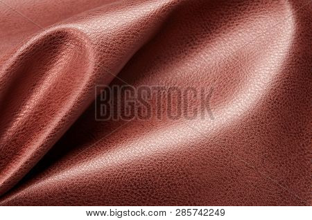 Brown eco leather. Artificial leather. Synthetic leather. Leatherette background. poster