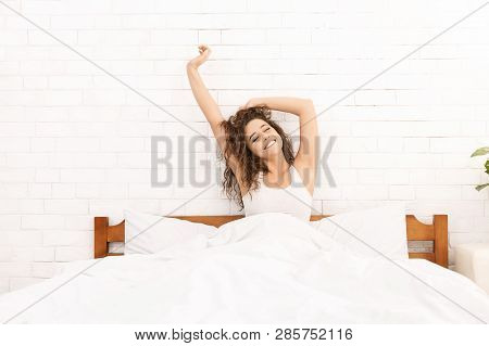 Good Night Sleep. Happy Relaxed Woman Stretching In Bed, Free Space