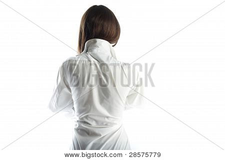 Back Of The Young Woman Of The Brunette In A White Shirt