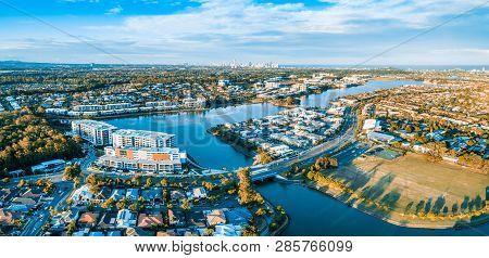Varsity Lakes Suburb Luxury Real Estate At Sunset. Gold Coast, Queensland, Australia - Aerial Panora