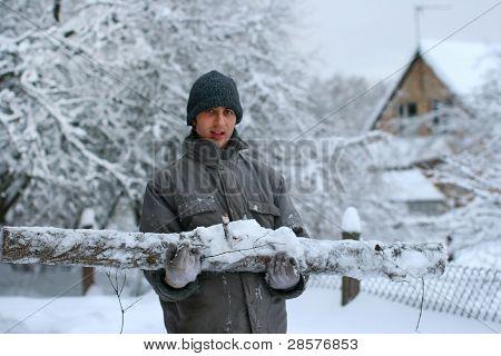 Forest Worker With Big Hewed Log