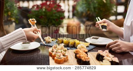 Colleagues Ordering Four Course Lunch On Special Offer. Friends Coming To Oriental Luxury Restaurant
