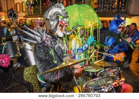 Participants In Costumes Perform A Street Procession At The Carnival