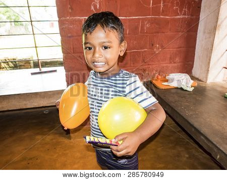 Puduchery, India - December Circa, 2018. Unidentified Poor Indian Little Boy Smiling And Playing Wit