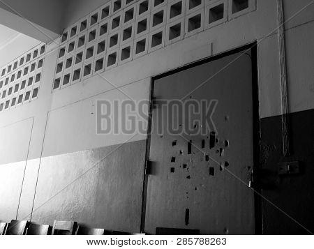 Many Broken Holes On The Old Classroom Door Are Locked