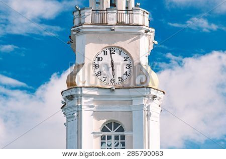 Beautiful Old White Tower Of Townhall In Vitebsk, Belarus, Europe. Blue Cloudy Sky In Background.