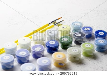 A Set Of Paints For Home Painting By Numbers. Hobby Painting Canvas With Acrylic Paints According To