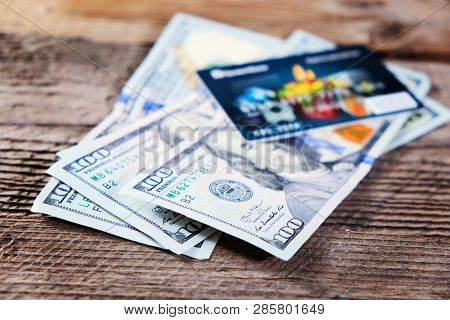 Photo Of The Bank Credit Cards And Moneys On The Wood Table, Selective Focus.