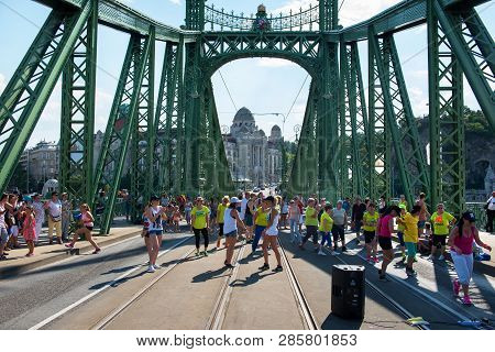 Budapest, Hungary - July 29, 2018: People Dancing On Liberty Bridge At Sunny Summer Day