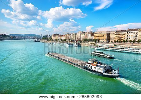 Cargo Ship In The Waters Of Danube River In Budapest
