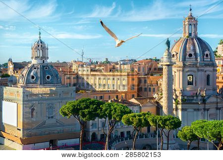 Trajans Column And Churches In Rome At Sunset