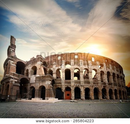 Ancient Colosseum And Bright Morning Sun In Rome
