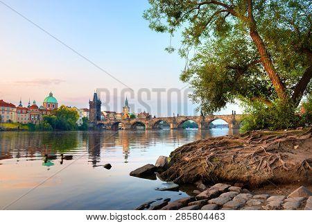 Famous Charles Bridge In Prague At Dawn