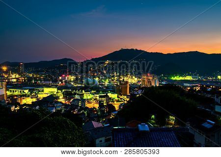 A Sunset From A Hill In Nagasaki, Japan, With View Over The Entire Center