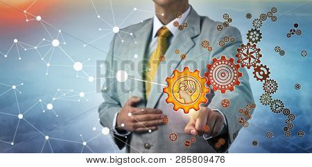 Unrecognizable Manager Touching An Artificial Intelligence Icon On A Cog Wheel In A Virtual Gear Tra