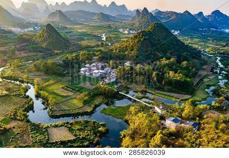 Sunset Overlooking The Li River Near Guilin, China. Li River Is Meandering Through Rice Paddies And