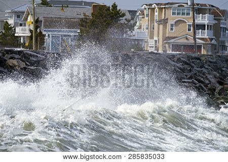Large Storm Waves Crashing Against The Seawall