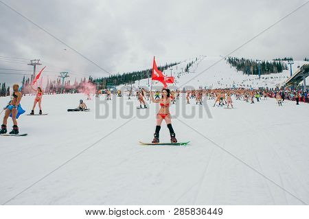 Sheregesh, Kemerovo Region, Russia - April 14, 2018 : Crowd Of People In Bikini And Shorts Riding Sn