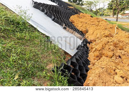 Slope Erosion Control Grids, Sheets And Earth On Steep Slope