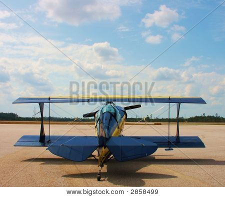 Biplane Under The Clouds